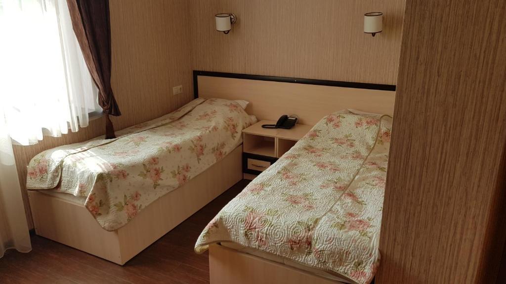 Кровать или кровати в номере Hotel-Restaurant Atmosfera