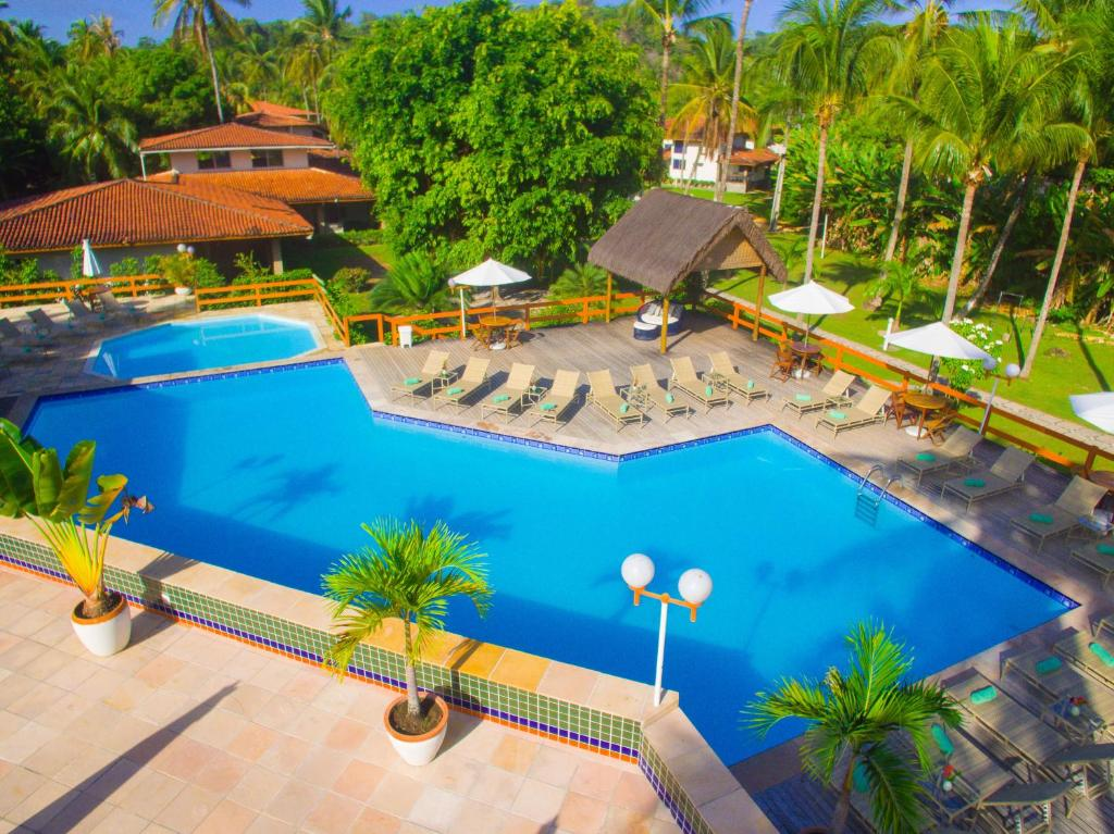 A view of the pool at Village Paraíso Tropical or nearby