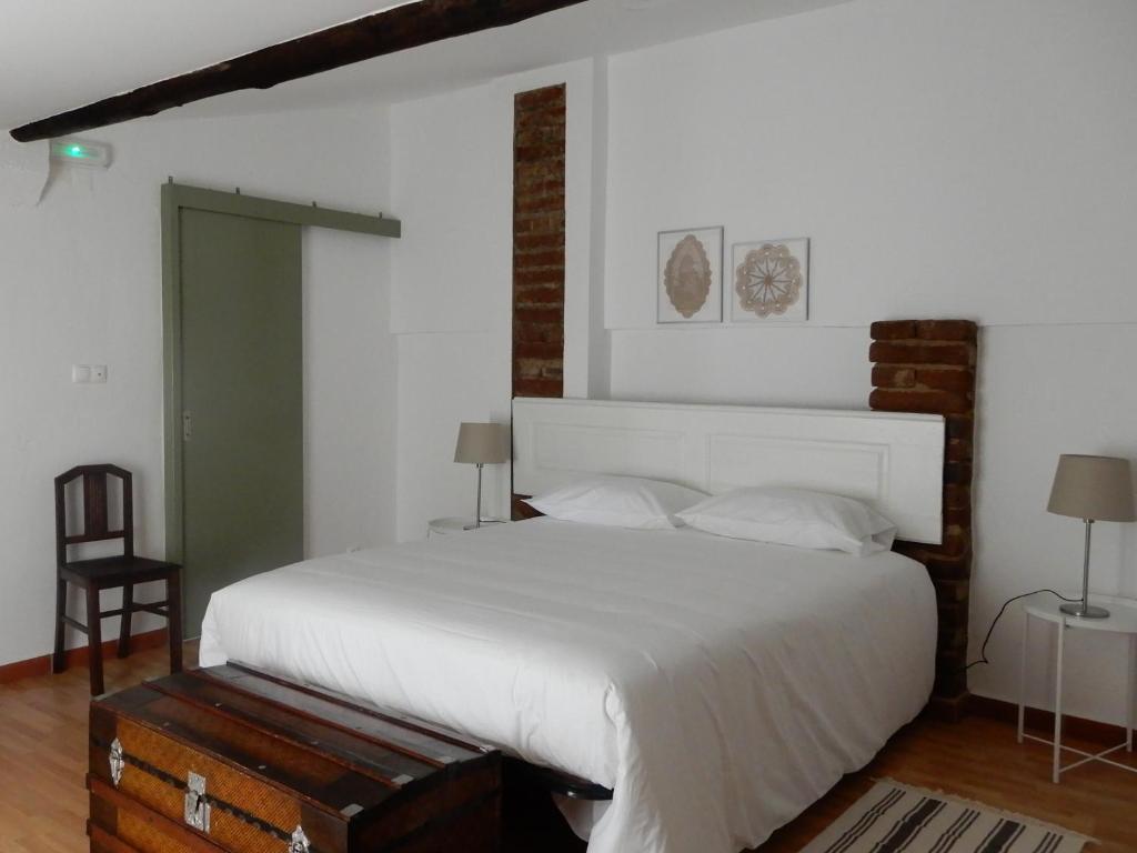 Uma cama ou camas num quarto em Casa da Cumeada