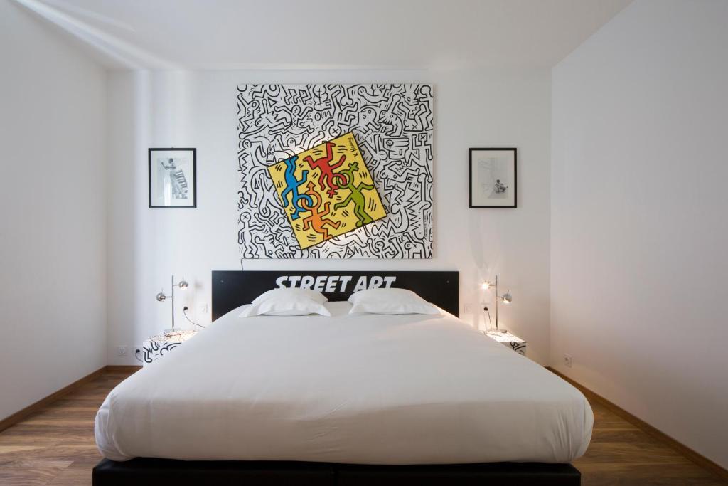 Un ou plusieurs lits dans un hébergement de l'établissement B&B La Maison Vintage