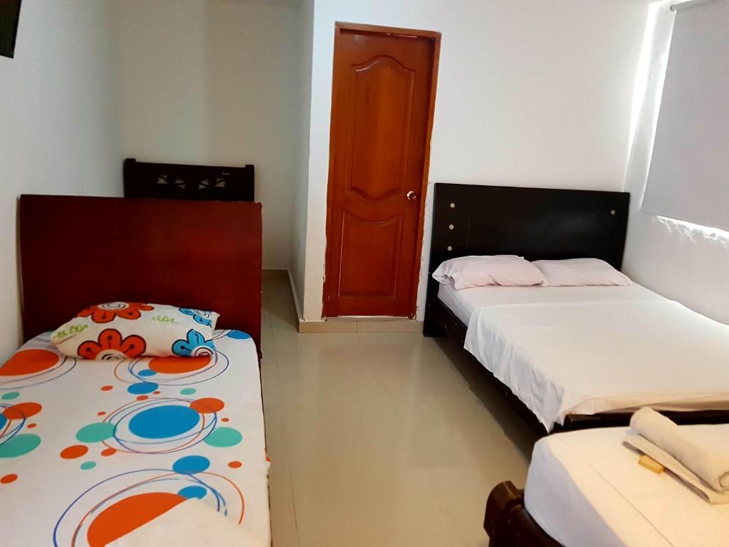 Кровать или кровати в номере Hotel Interamericano