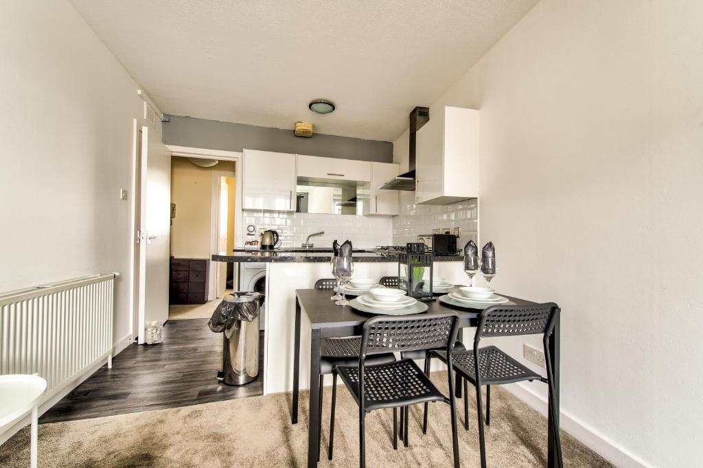 A kitchen or kitchenette at No.5 Serviced Apartment