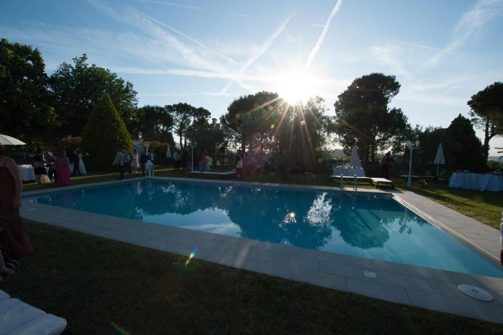 The swimming pool at or near Agriturismo al Colle