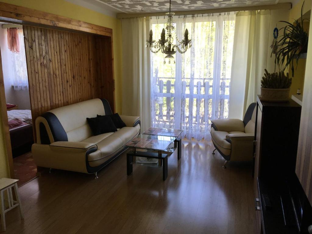 A seating area at Horsky apartman Medenec