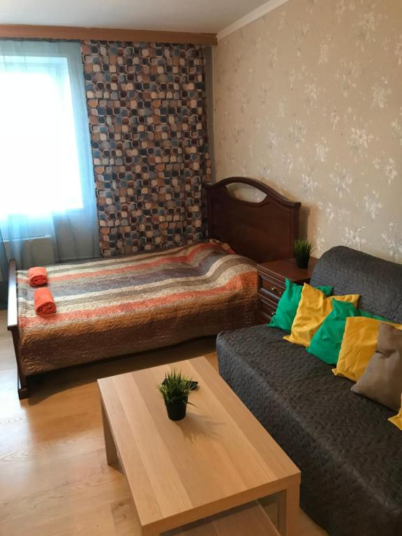 A bed or beds in a room at Ангарская 67/3