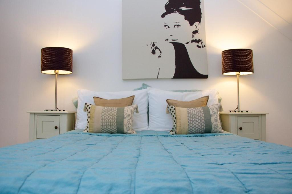 A bed or beds in a room at Onefifty