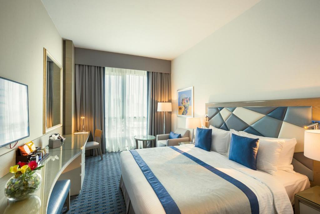 A bed or beds in a room at Roda Links Al Nasr