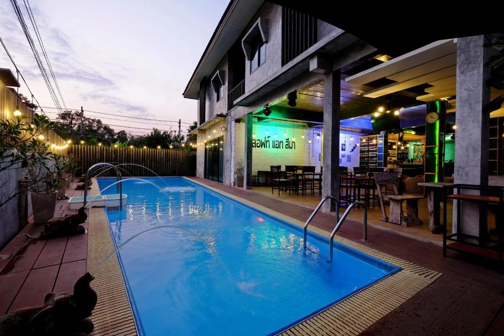 The swimming pool at or near Loft@Sima