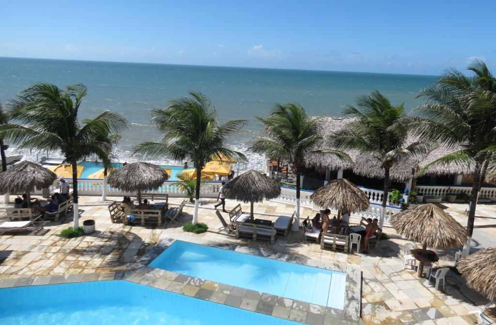A view of the pool at La Suite Praia Hotel or nearby