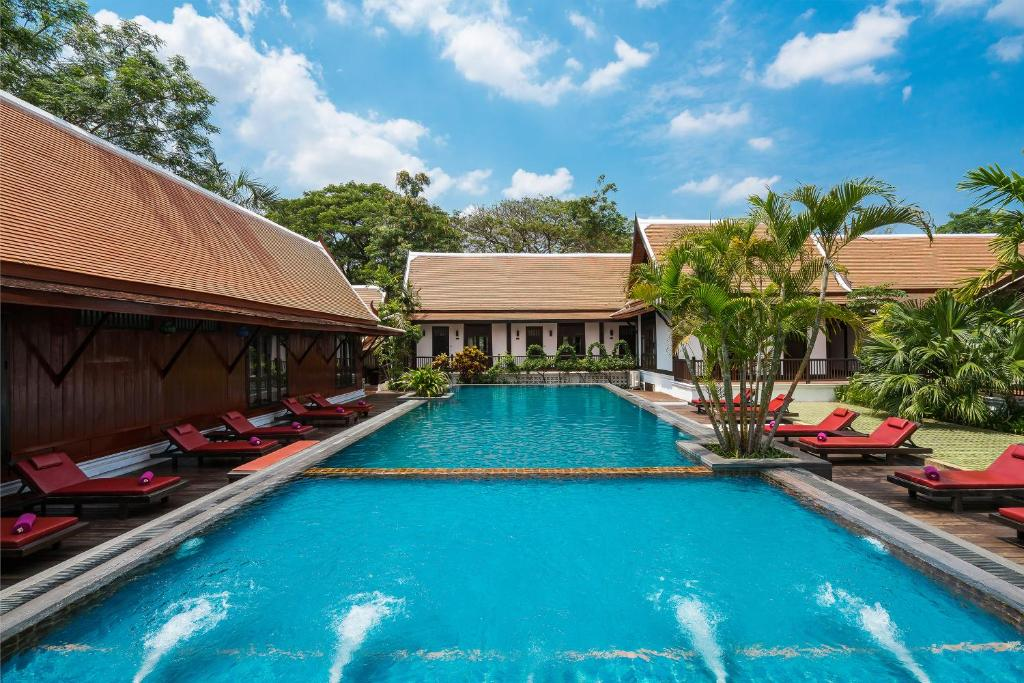 The swimming pool at or near Legendha Sukhothai Hotel