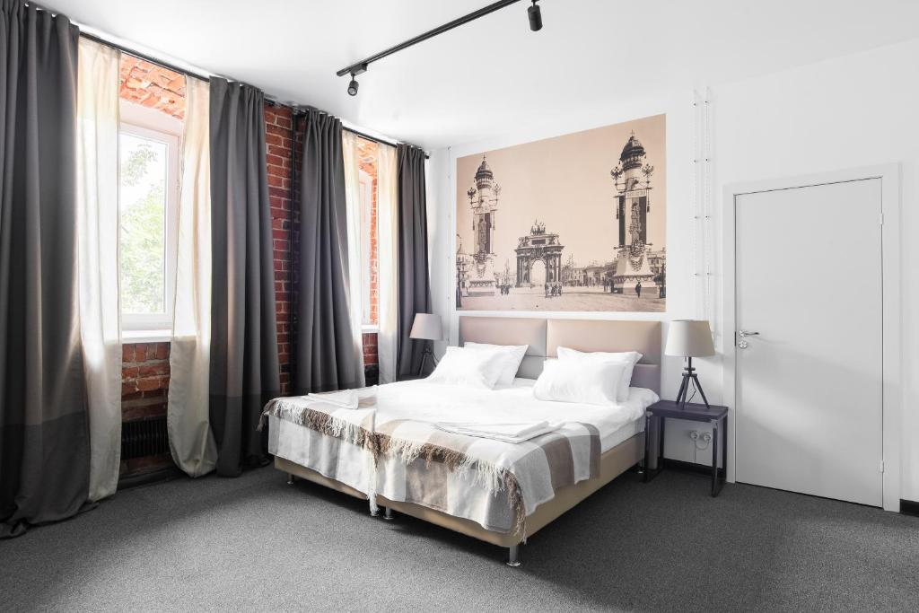 A bed or beds in a room at Alliance Tverskaya zastava