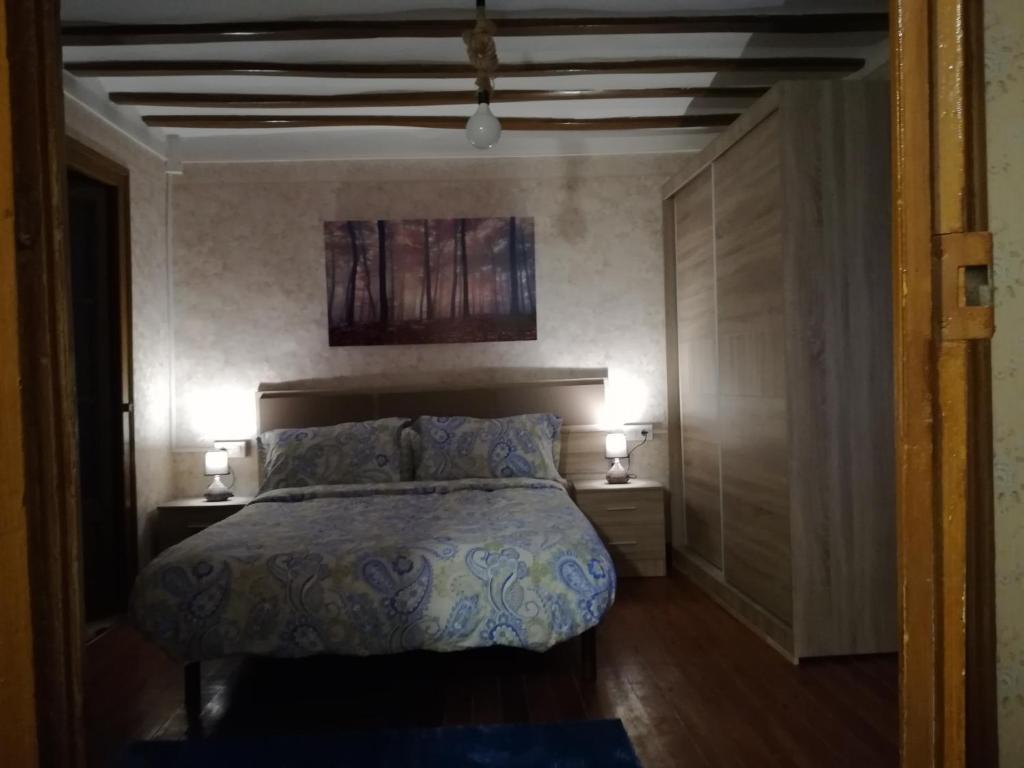 Cama o camas de una habitación en Alojamiento Santa Engracia Laguardia