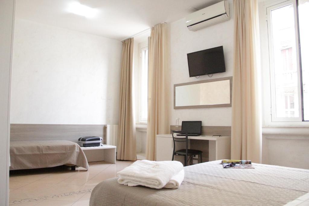 En eller flere senge i et værelse på Hotel Siro