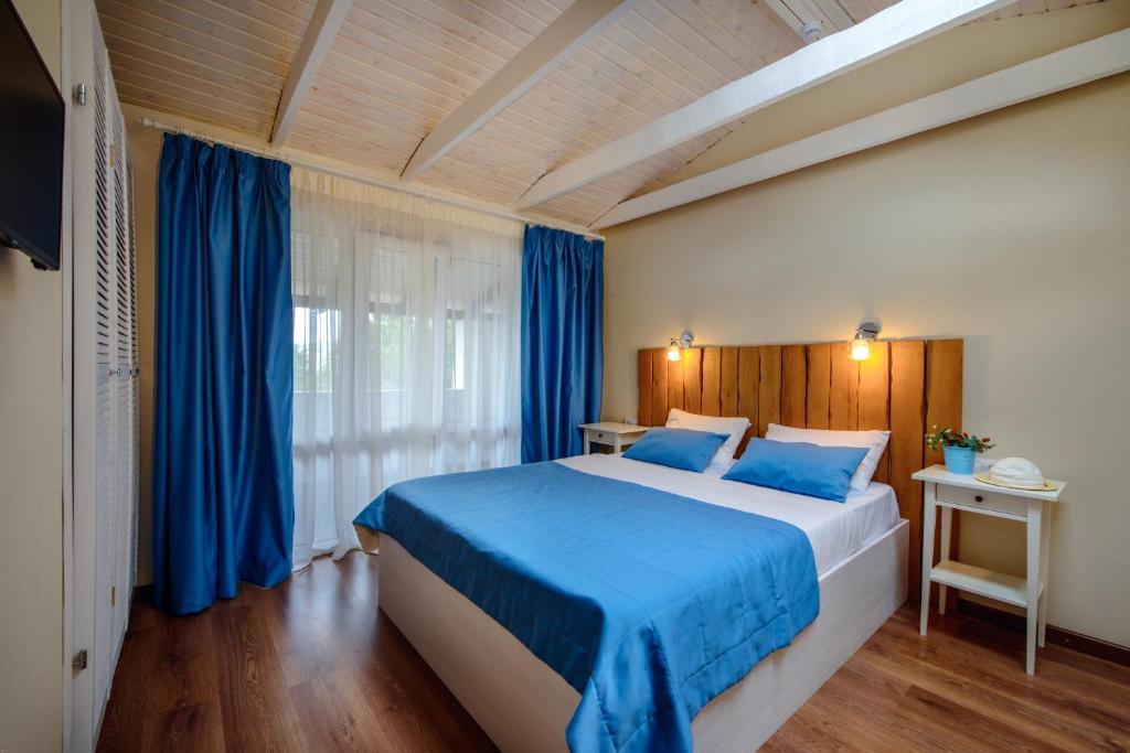 Кровать или кровати в номере Парк-отель Salute