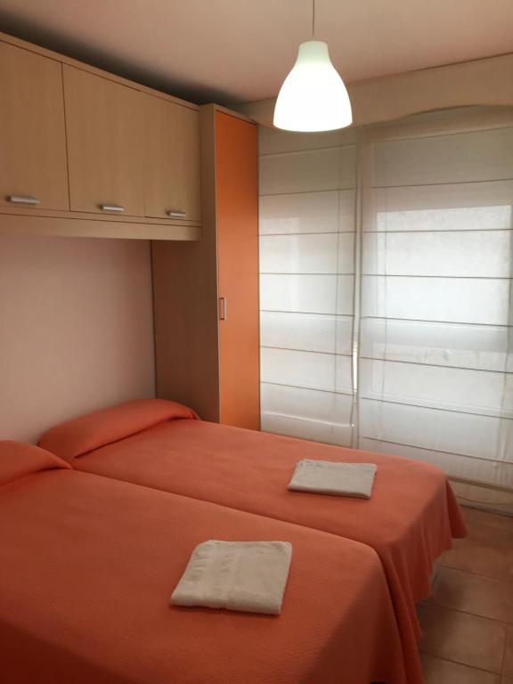 Cama o camas de una habitación en Apartamentos San Guillermo