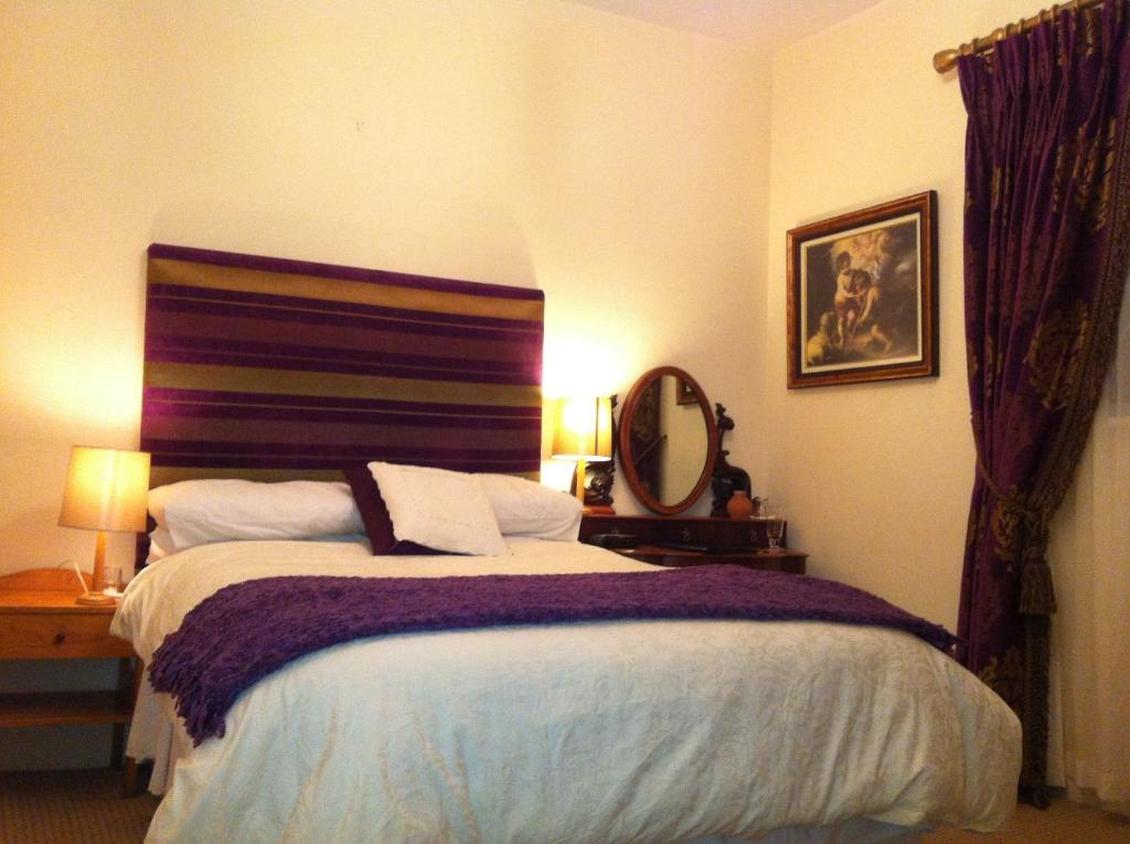 A bed or beds in a room at The Blue Door Bed & Breakfast