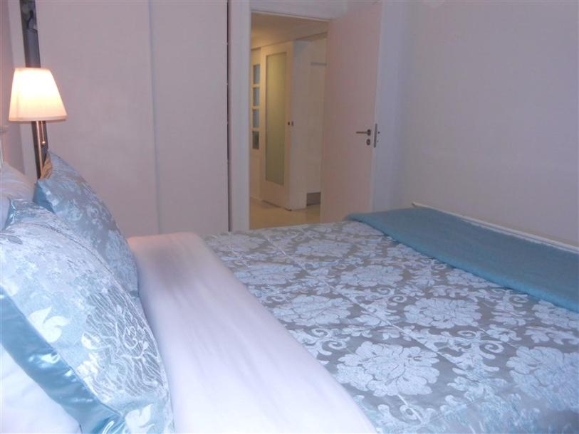 A bed or beds in a room at CASA DA ALAMEDA - 2oANDAR