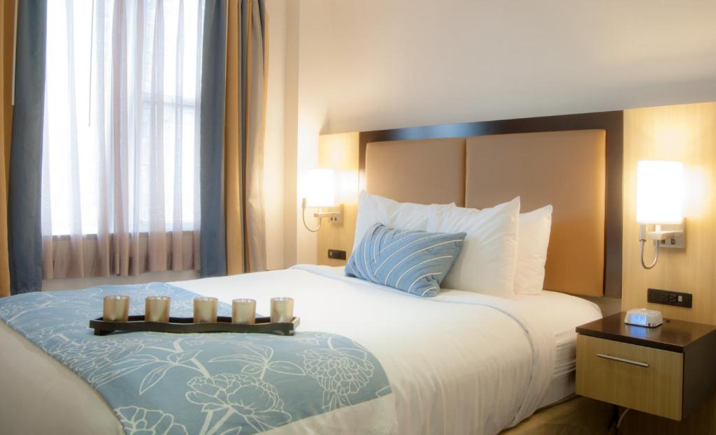 Postelja oz. postelje v sobi nastanitve Madison LES Hotel