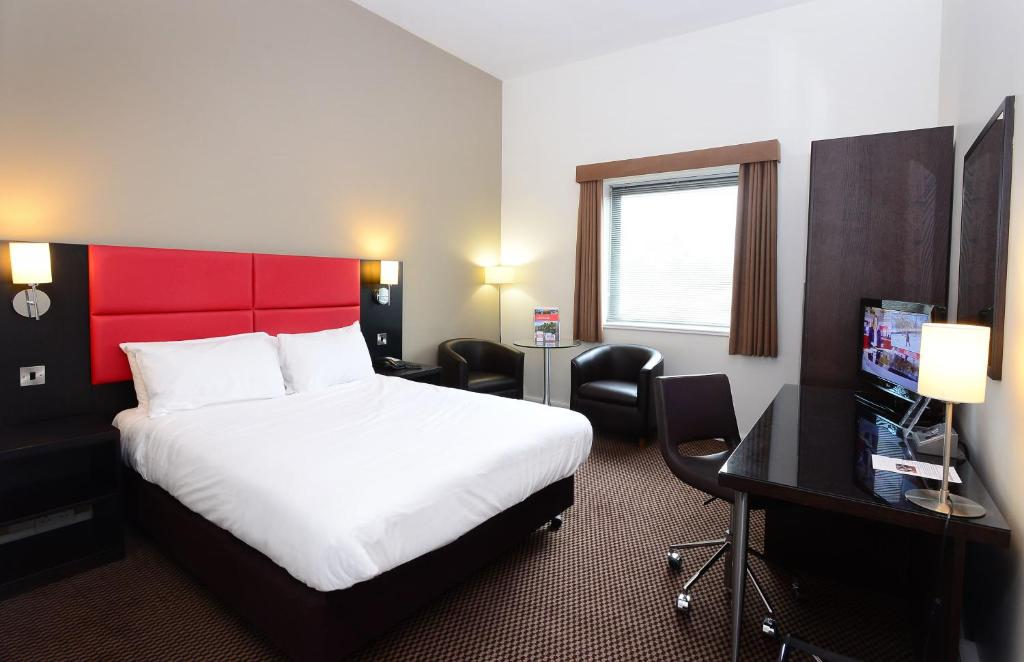 A bed or beds in a room at International Hotel Telford