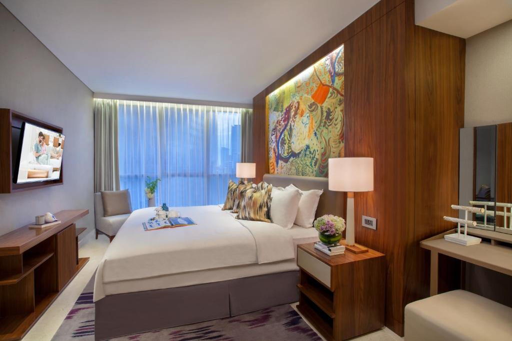 A bed or beds in a room at Ascott Sudirman Jakarta