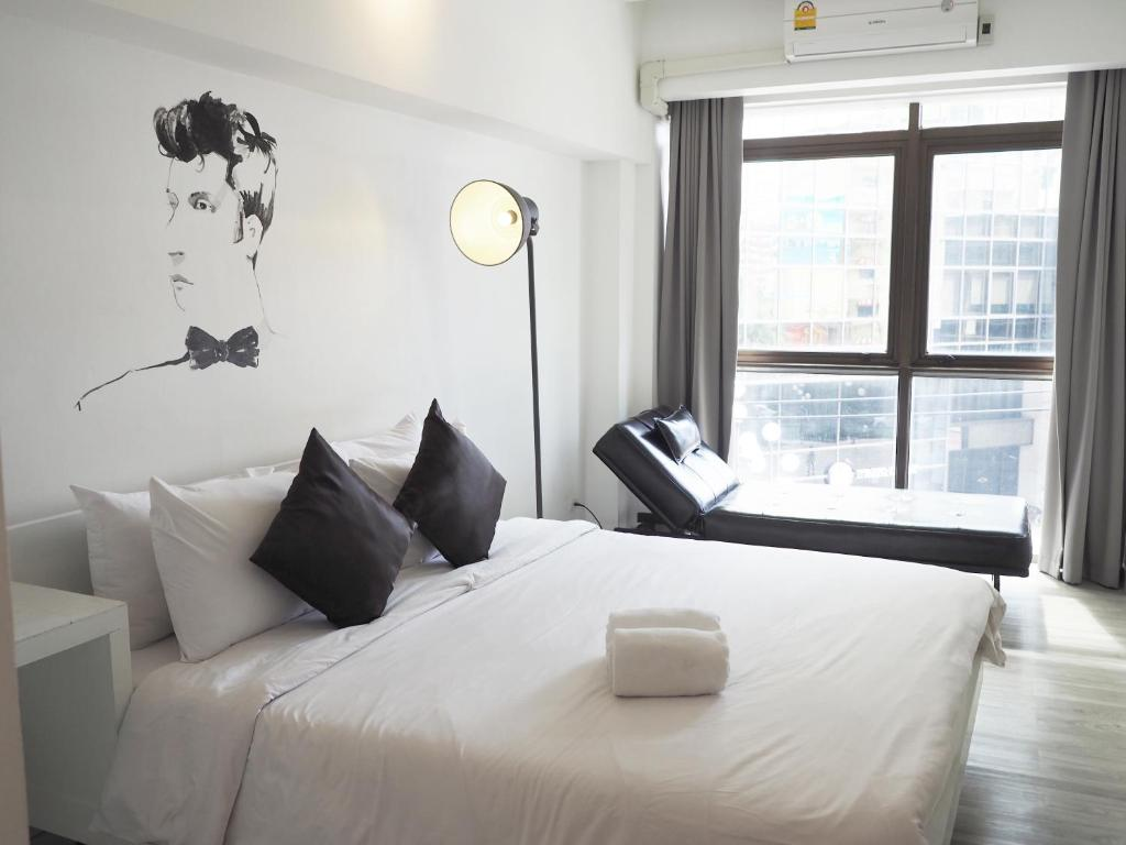 A bed or beds in a room at 3Howw Hostel @ Sukhumvit 21