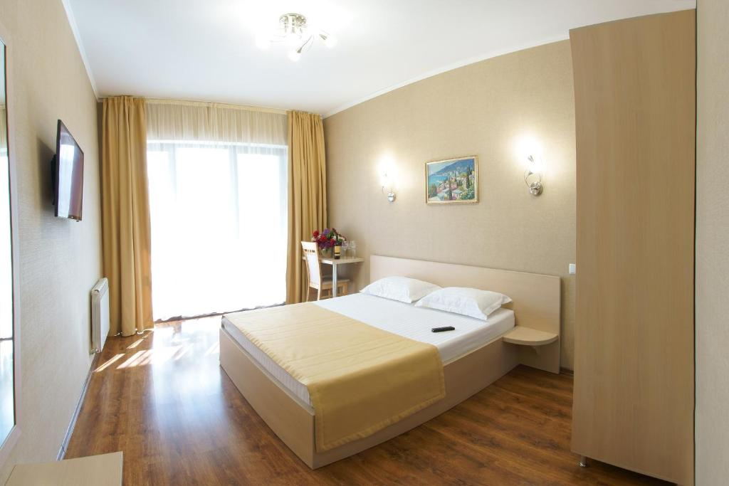 A bed or beds in a room at Darya Hotel
