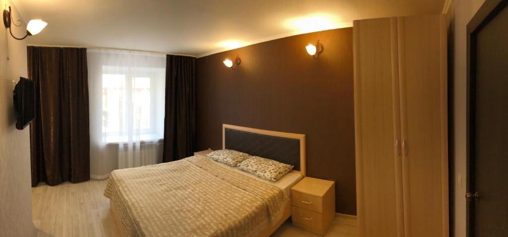 Кровать или кровати в номере Аврора Центр Гостевые комнаты