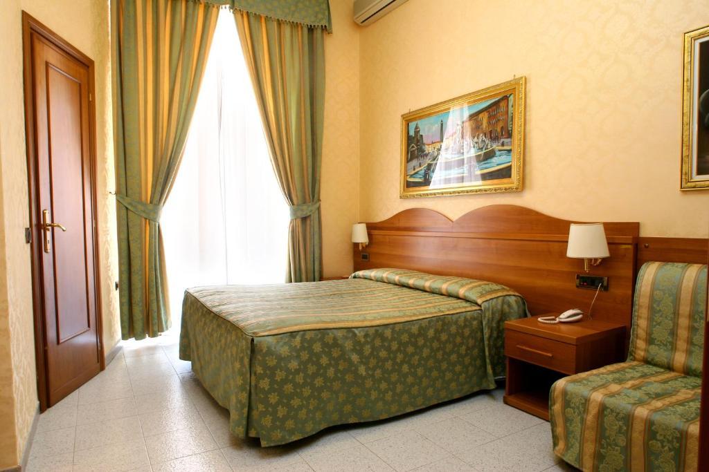 Un ou plusieurs lits dans un hébergement de l'établissement Hotel Teti