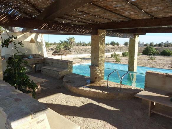The swimming pool at or near Bella Djerba