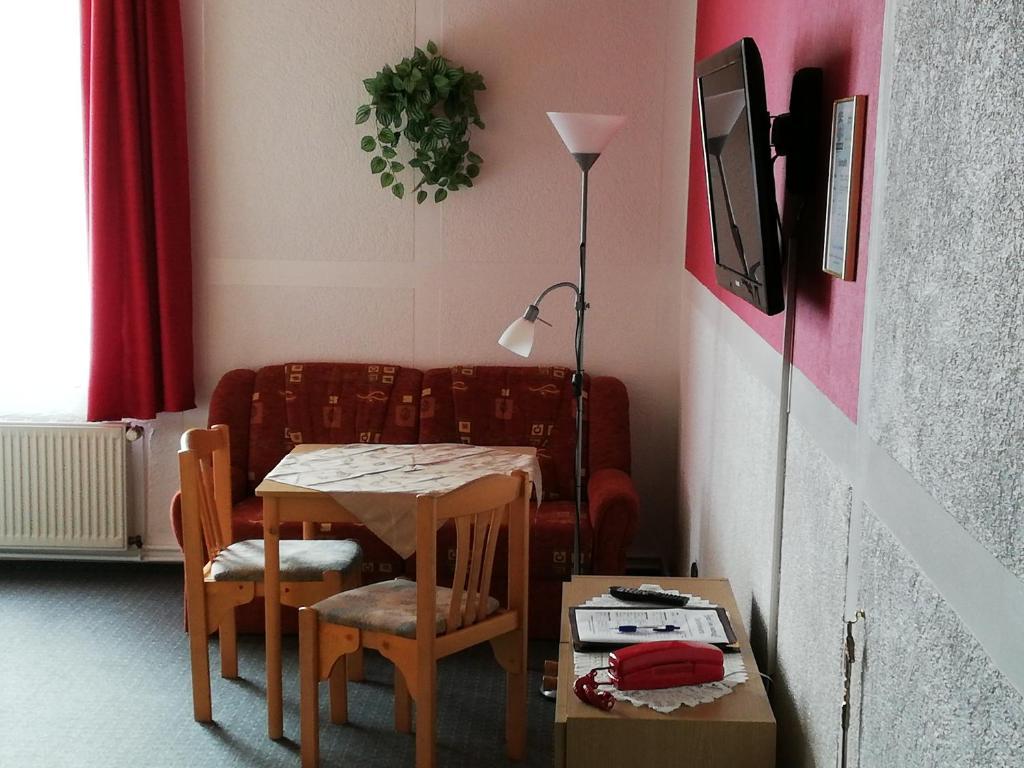 Ein Restaurant oder anderes Speiselokal in der Unterkunft Hotel Am Stadtwall