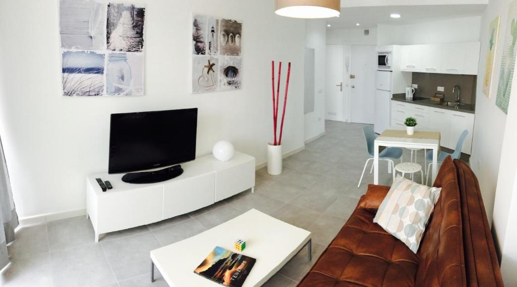 A television and/or entertainment center at Apartment Carmen Sunrise, Los Cristianos