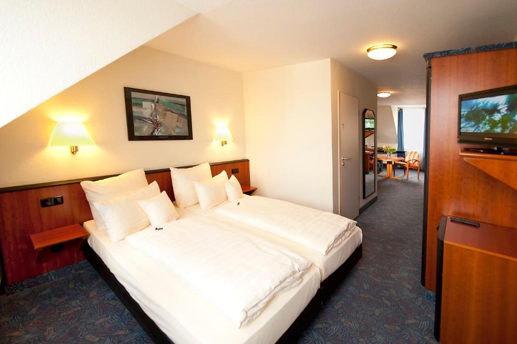 Ein Bett oder Betten in einem Zimmer der Unterkunft Advantage Appartements Hotel