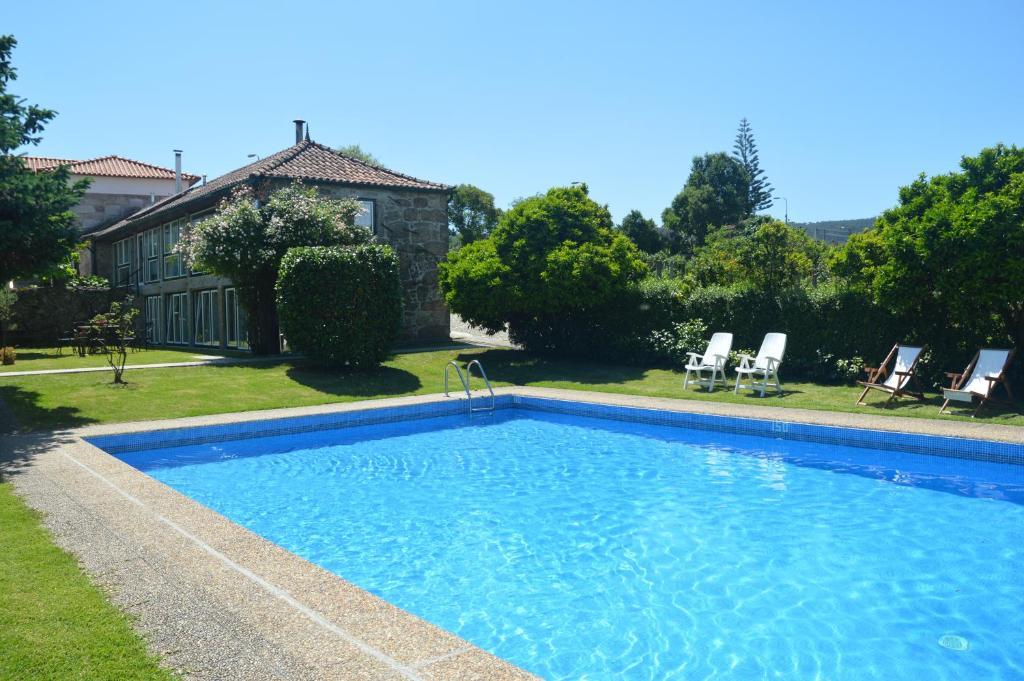 A piscina em ou perto de Casa Do Carvalho