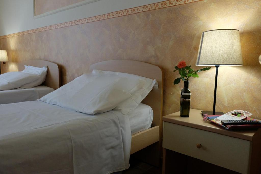 Letto o letti in una camera di Hostel il Tetto