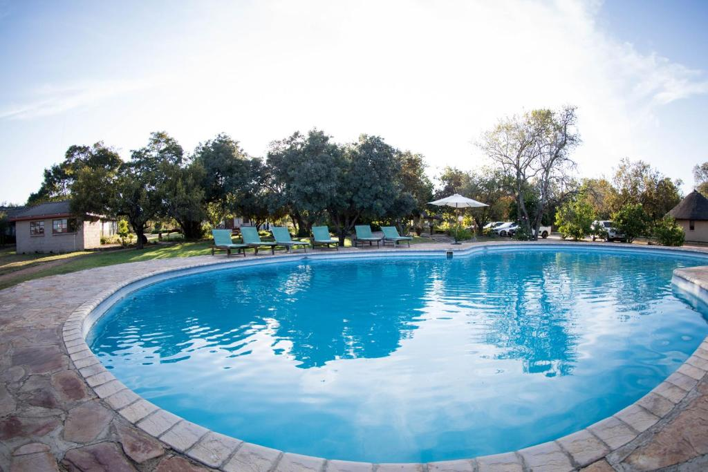 The swimming pool at or near Dzata Private Game Lodge