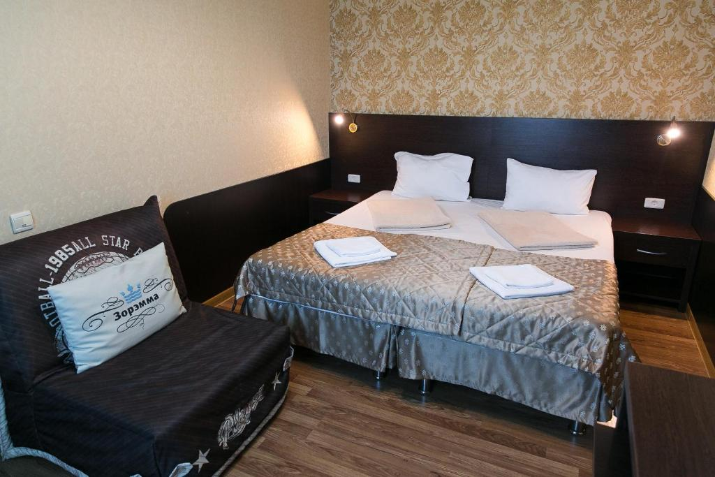 A bed or beds in a room at Zoremma Mini-hotel