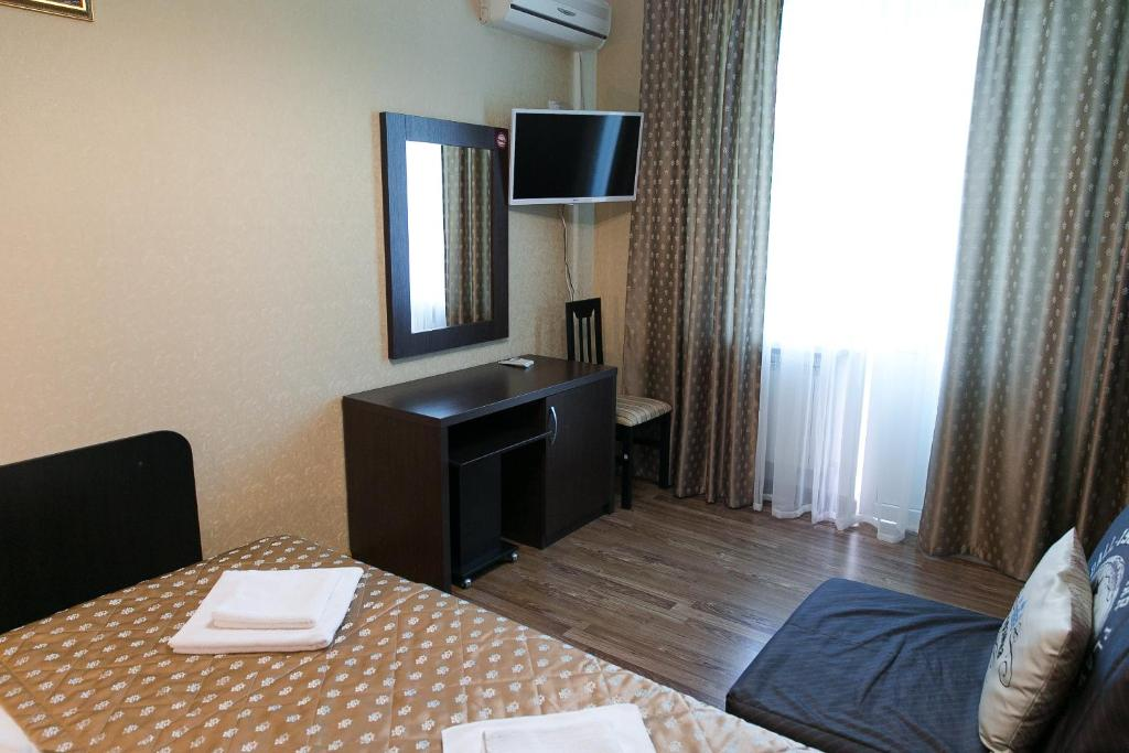 A television and/or entertainment center at Zoremma Mini-hotel