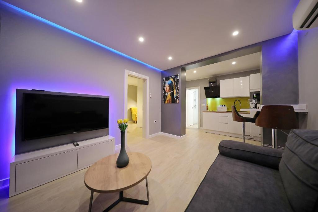 A television and/or entertainment centre at City Marine Luxury Apartments