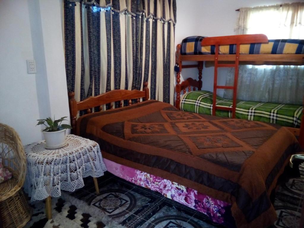 A bunk bed or bunk beds in a room at Paseo las Vinas
