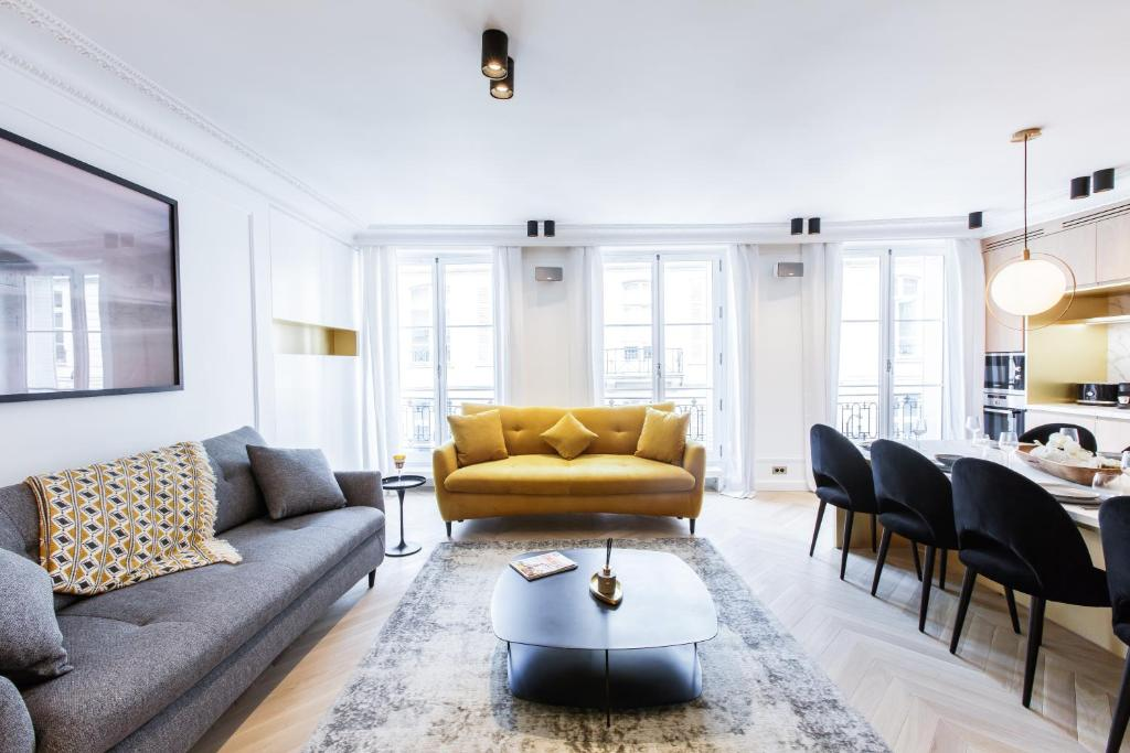 A seating area at HighStay - Louvre / Saint Honoré Serviced Apartments