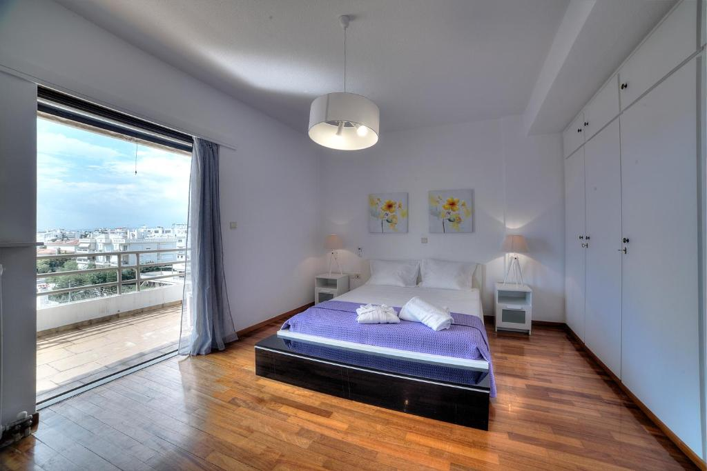 A bed or beds in a room at Athens Glyfada Riviera Apartment