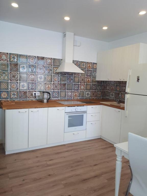 Кухня или мини-кухня в Na beregu moria