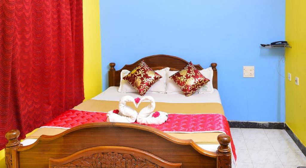 Malar Residenceyにあるベッド