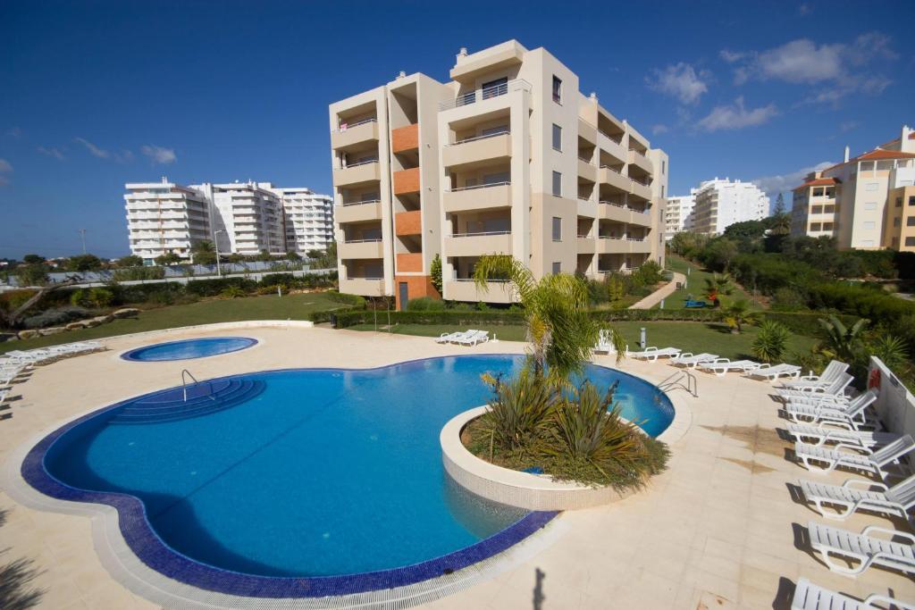 The swimming pool at or near Areias da Rocha by amcf