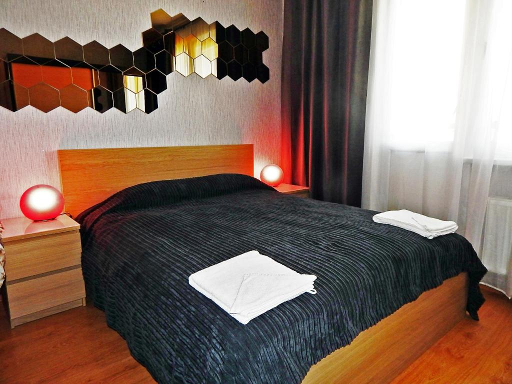 A bed or beds in a room at Apartment Hanaka Jubileinyi 78