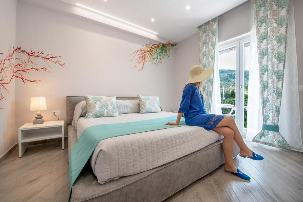 A bed or beds in a room at Cioffi Sorrento rooms