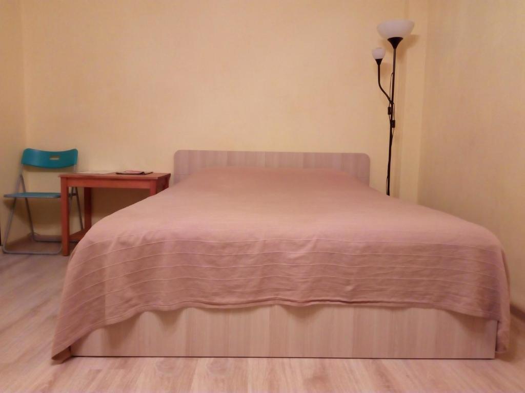 Кровать или кровати в номере Apartment on Sovetskaya 24