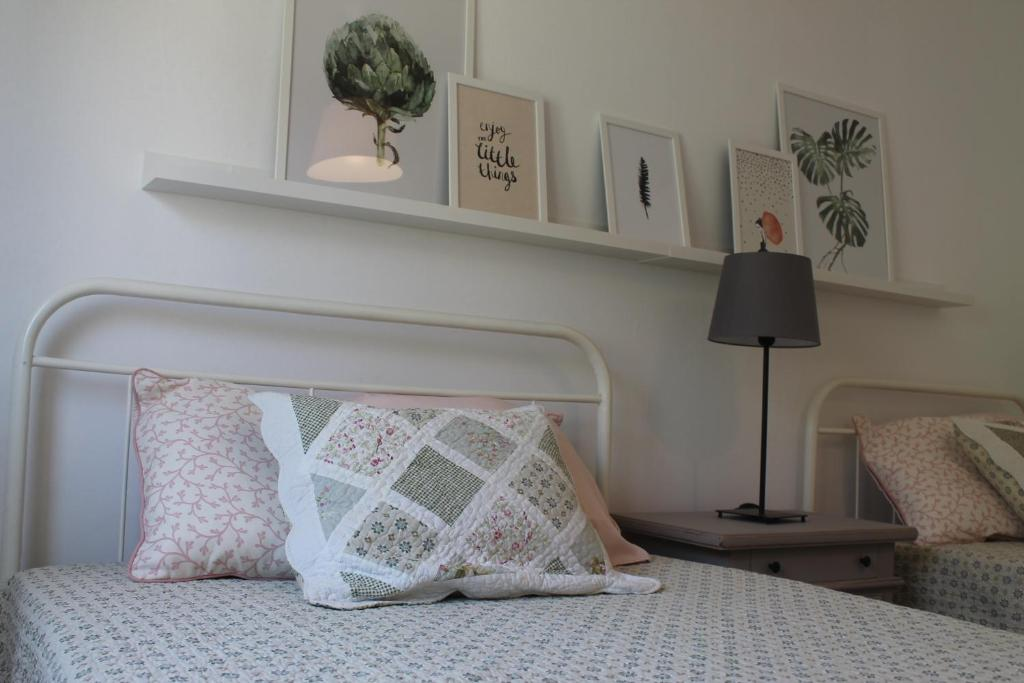 A bed or beds in a room at Charming baixa