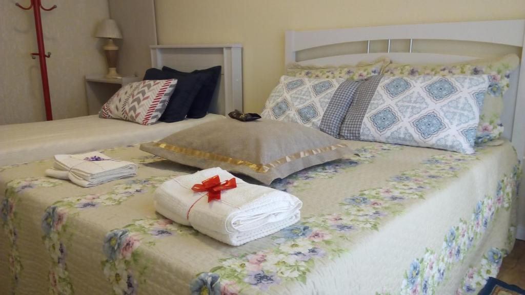 A bed or beds in a room at Apartamento Lindo