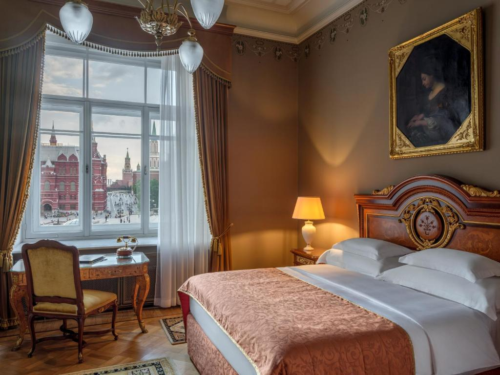 A bed or beds in a room at Hotel National, a Luxury Collection Hotel in Moscow